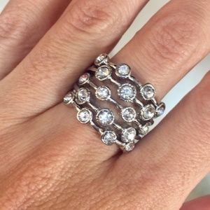 Gorgeous Silvertone and White Crystal accents Ring